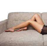 Long Woman legs in stockings on sofa. sexy women legs on sofa