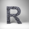 Letter R made out of scrambled small letters in studio setting