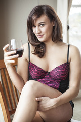 Young Woman in Lingerie Drinking Red Wine