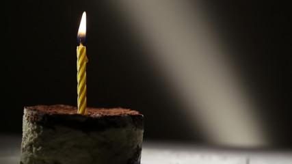 One candle in tiramisu cake.