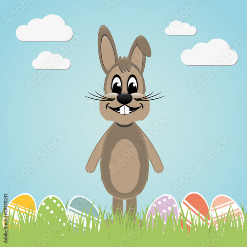 brown easter bunny lawn and colorful eggs