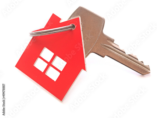 silver key with house figure on the white background