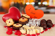 Sweet cookies with hearts and valentine card on table in cafe