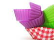 Colorful paper cup cake cases on white background