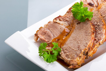 Slices of homemade roast pork on the plate