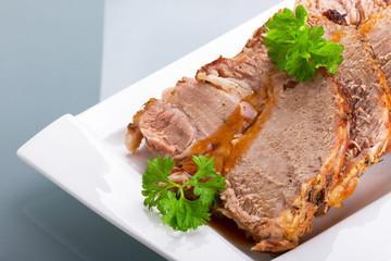 Slices of homemade roast pork on the plate