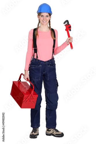 Tradeswoman with a pipe wrench
