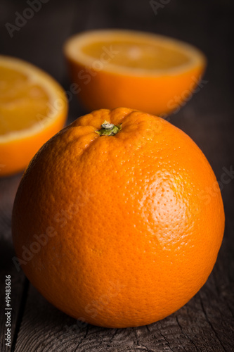Close-up of orange fruit on wooden table.