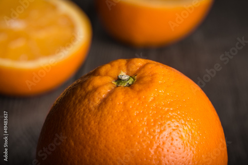 Close-up of orange fruit on wooden surface.