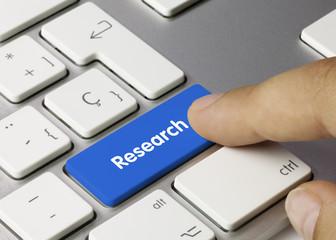 Research keyboard key. Finger