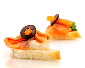 Sandwich with salmon, cream and olive