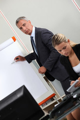 Businesspeople at a white board