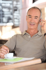 Retired man drinking coffee