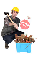 Foreman showing stop sign