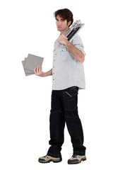 tiler holding tiles in studio background