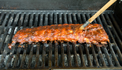 Applying Sauce to BBQ Baby Back Ribs