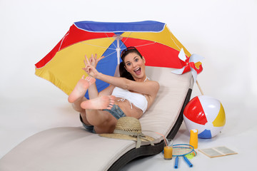 Girl jumping on hammock with beach accessories