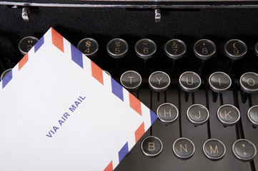Typewriter with air mail envelop, close up