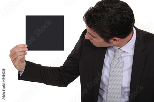 Businessman looking at a blank square