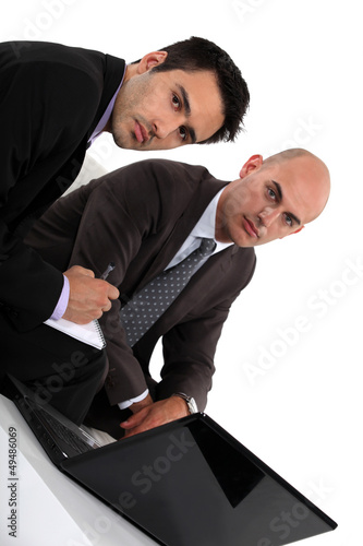 Two businessmen preparing meeting