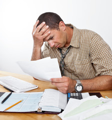 Worried Young Man with Debt and Bills