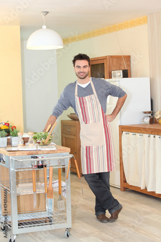 Man preparing a meal in his kitchen
