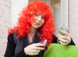 Woman in red wig