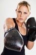 Portrait of a female boxer punching