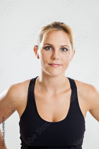 Portrait of a fit woman on a white background