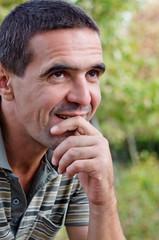 Smiling pensive man
