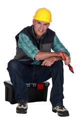 Workman sitting on a toolbox