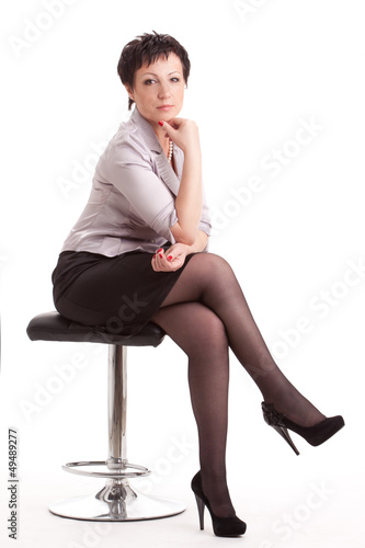 adult businesswoman sitting on chair over white