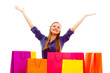 happy woman standing behind shopping bags
