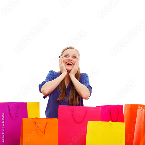 happy woman behind shopping bags