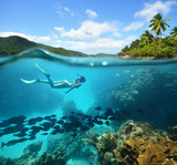 Beautiful Coral reef with lots of fish and a woman