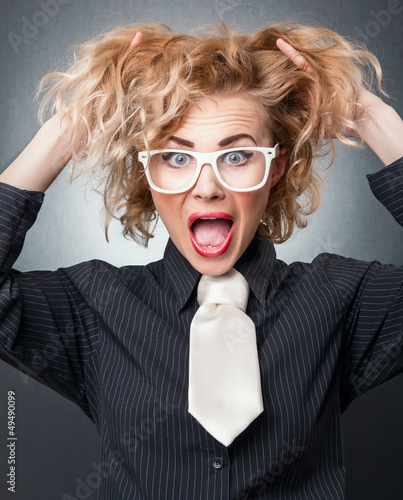 Business woman screaming , isolated on gray