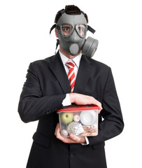 Business man with gas mask holding nutrition, survival concept