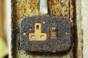 Old rusty 3 pin plug socket and switch