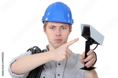 Technician pointing to CCTV camera