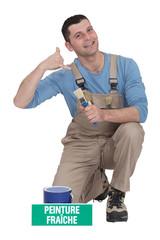 Decorator making telephone gesture