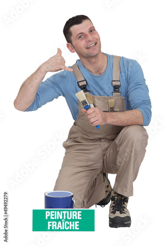 Decorator making telephone gesture