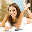 Young beautiful woman studying with notebook