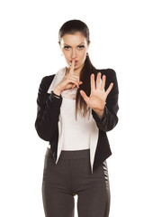 Young Brunette Gesturing for Quiet or Shushing, With Stop Hand