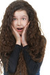 surprised schoolgirl with dark curly hair