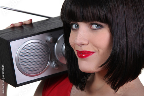 Gorgeous woman with a radio on her shoulder