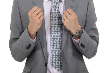 Angry businessman clenching his fists