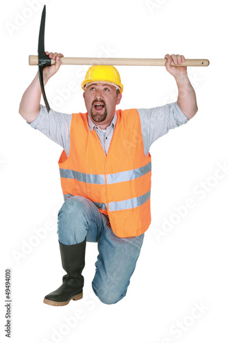 Man kneeling with pick-ax