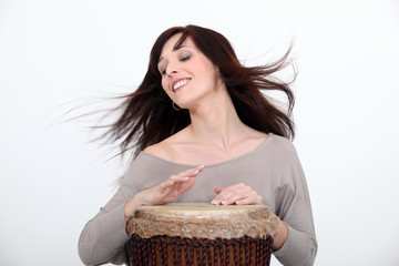 Woman playing bongo