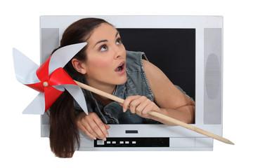 Woman crossing TV screen