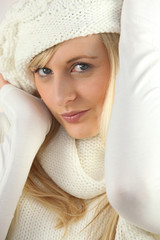 Woman wearing white hat and scarf